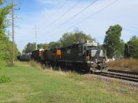 1016 1534 wb local with ex-NS 5570 and BNSF 543 cr.JPG