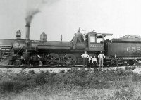 SLSF #658 and Joseph WIlliam Vinson (standing on loco) Springfield Mo ca 1910.jpg