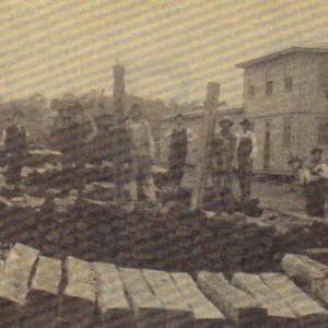 This picture is a clipping from the Douglas County Herald from 1991. It features the Ava, MO depot with piles of crossties. Photo dates to about 1915.