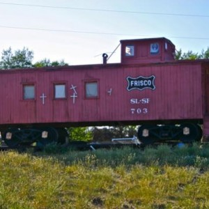 SLSF caboose 703, photographed on July 7, 2009, just outside of Taos, NM, on US Highway 64, en route to Rio Grande Gorge Bridge. Caboose was on privat