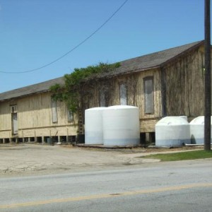 Main Street freight depot. Main Street in the foreground. The short white tanks are 5 and a half feet tall.