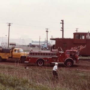 That old firetruck fits right in with those early 70s Frisco section gang trucks. Those 1400 series cabooses did not have radios by the way. I doubt t