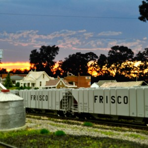 Blairstown, MO. Photoshopped in a sunrise backdrop, everything else is N scale. What a difference a good backdrop makes!