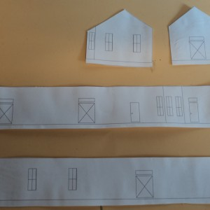 Paper ctuouts for exterior of Scammon KS Depot for fitting of windows and doors.