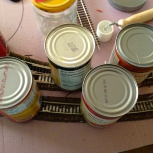 third section 2 : Canned goods are excellent weights to hold the flex-track into the Dap 320 adhesive until it dries.
