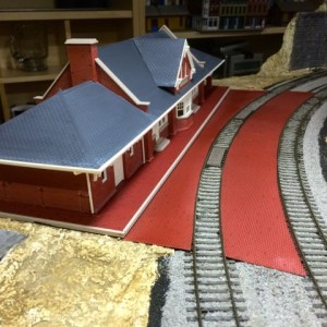 depot bricks 4 - The center platform is in. Some additional paint touchup, weathering, and landscaping around it will improve the look. The parking lo