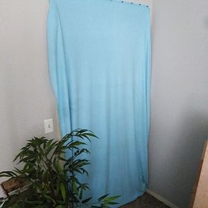Curtain over closet opening