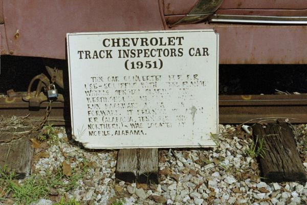 A sign by a Track Inspectors Car read: Chevorlet Track Inspectors Car (1951) This car converted for R.R. use - equipped with steel flange wheels, spec
