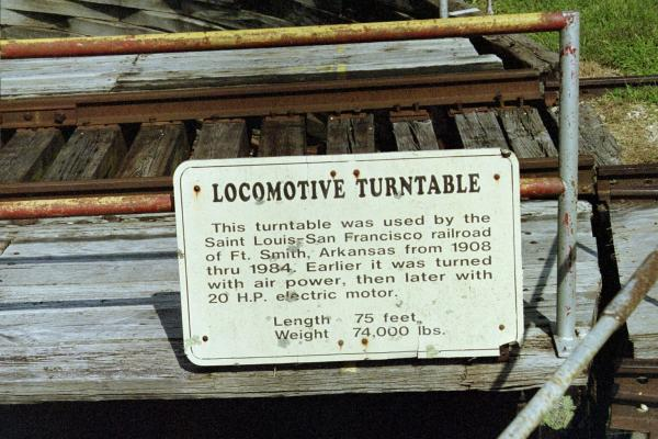 A sign on the Locomotive Turntable read: Locomotive Turntable This turntable was used by The Saint Louis - San Francisco Railroad of Ft. Smith, Arkans