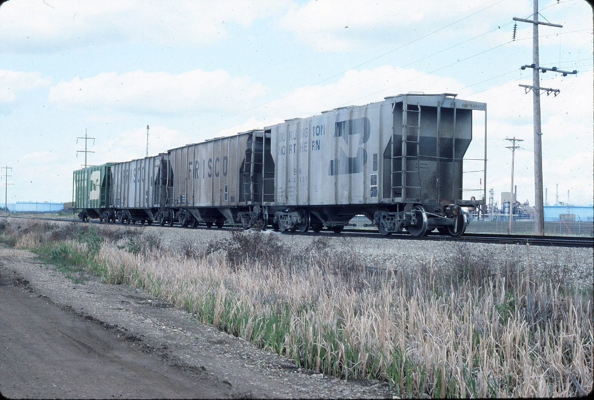Covered Hopper car line up BN/SLSF/SLSF/BN - June 1986 - East Edmonton, Alberta