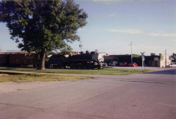 Okmulgee and Northern consolidateion steamer on former Leaky Roof line in Belton, MO 1992